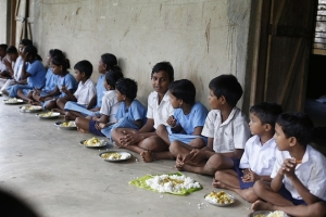 Mid Day Meal Beneficiaries of Askhaya Patra having lunch in a school of Puri.